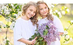 two girls holding flowers