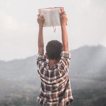 Boy holding Bible